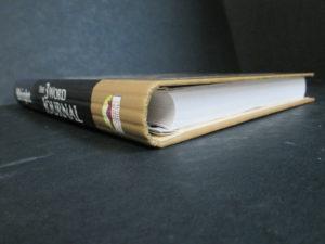 Книга з круглим корінцем і прихованої пружиною