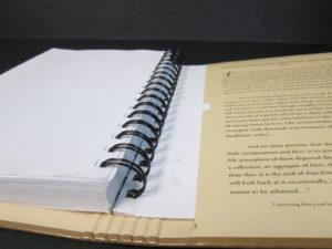 книга. Обкладинка з Палітурні картону. Пружина прихована обкладинкою